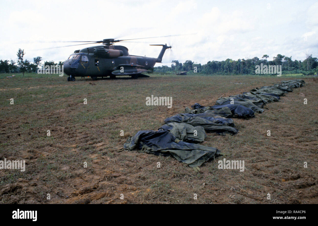 1978 - A US Air Force HH-53 Jolly Green Giant helicopter from the 55th Aerospace Rescue and Recovery Squadron stands by to assist in the removal of the remains of the victims of the Jonestown tragedy. - Stock Image