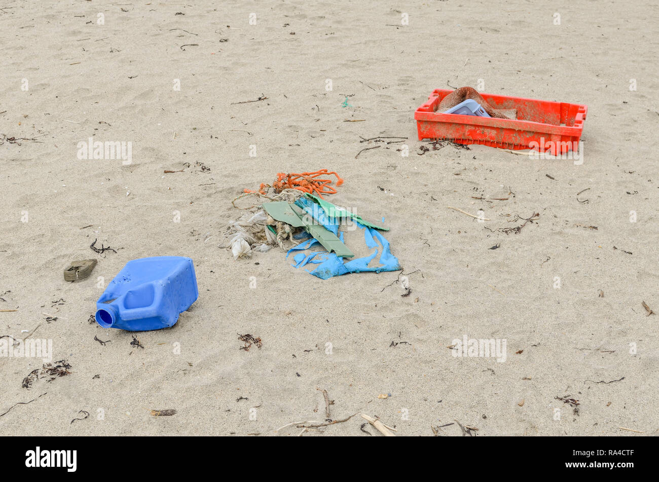 Variety of plastic pollution washed up on Perranporth Beach, North Cornwall. Metaphor plastic sea pollution, environmental pollution, war on plastic. - Stock Image