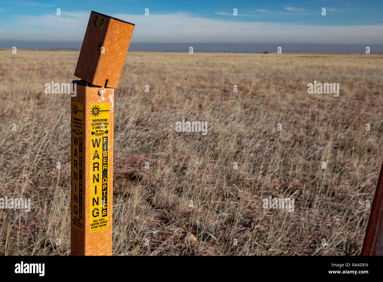 Denver, Colorado - A marker shows where an underground fiber optic cable runs through Rocky Flats National Wildlife Refuge,. - Stock Image