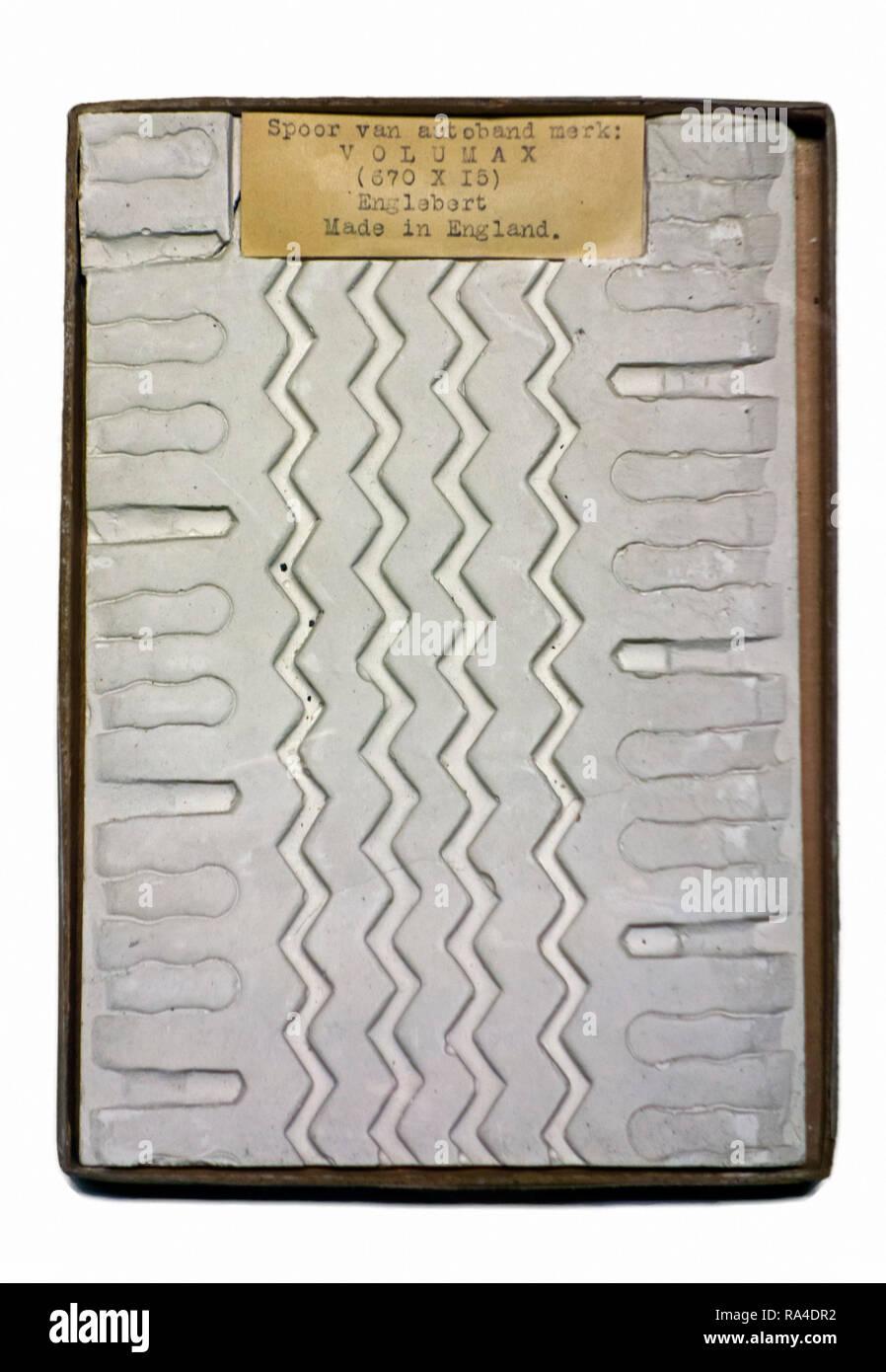 Plaster cast of tread pattern of car tyre / tire taken at crime scene for criminal investigation - Stock Image