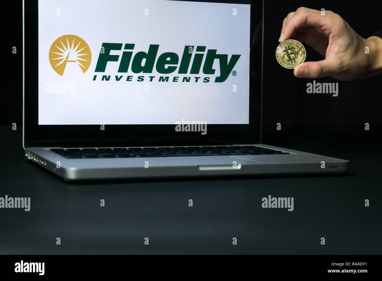 Bitcoin coin with the Fidelity logo on a laptop screen, Slovenia - December 23th, 2018 - Stock Image