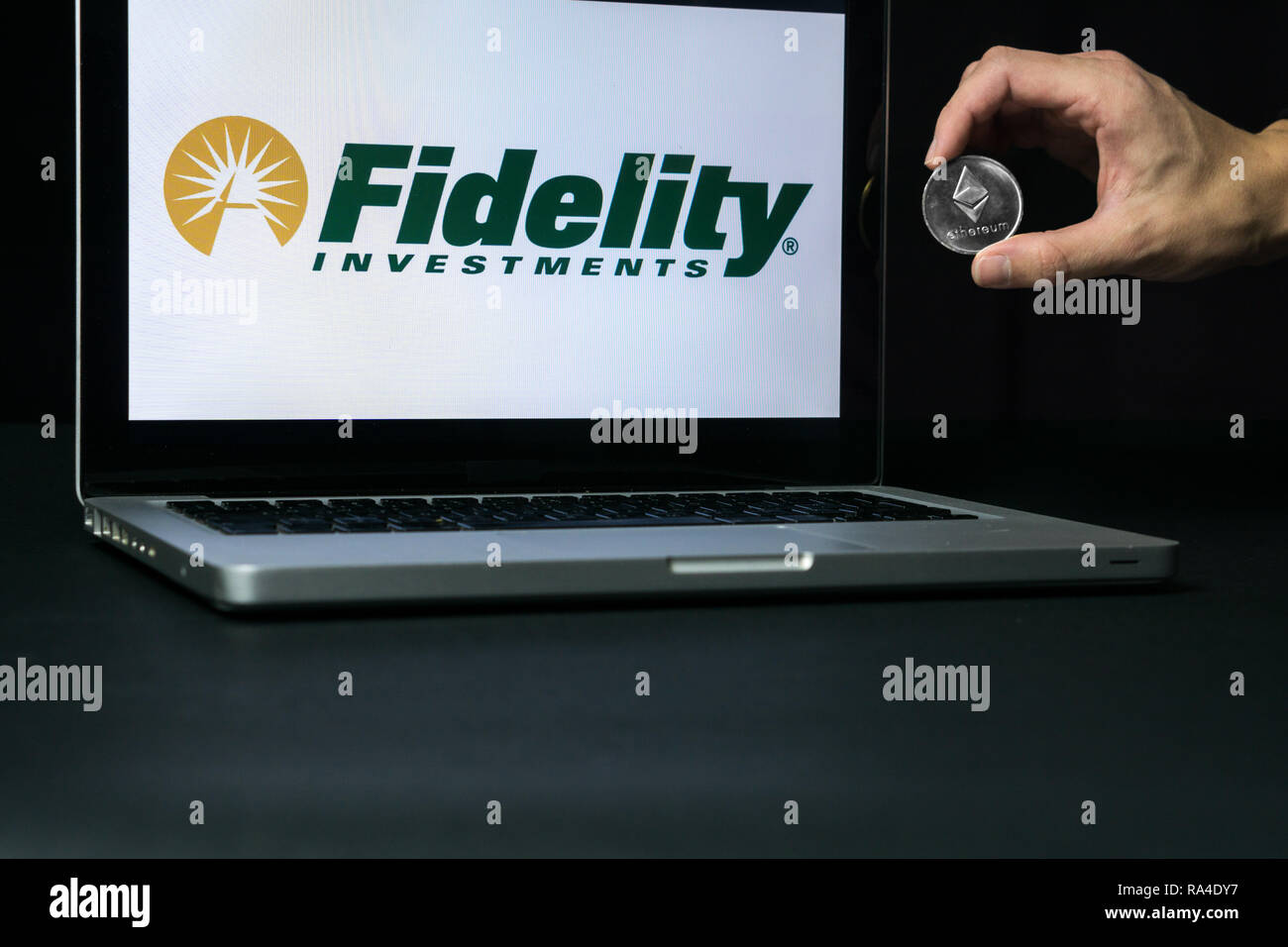 Ethereum coin with the Fidelity logo on a laptop screen, Slovenia - December 23th, 2018 - Stock Image