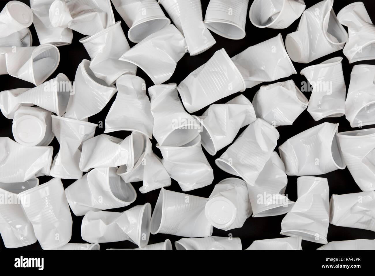 Disposable cup, plastic cup, in white, 0, 2 litres, drinking cup, disposable cup, plastic waste, used, crushed, crumpled - Stock Image