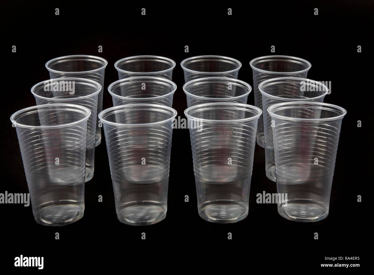Disposable cups, plastic cups, transparent, 0, 2 litres, drinking cups, disposable cups, plastic waste - Stock Image