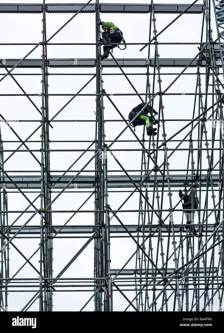Scaffolders at work, building a large scaffolding, work at high altitude, Germany - Stock Image