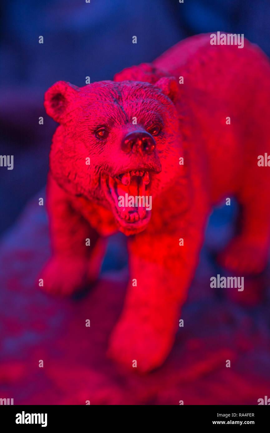Toy bear standing on rock against plain background, all colour lit. Metaphor bear market, market bears, Stock Market bearish,being bearish. - Stock Image