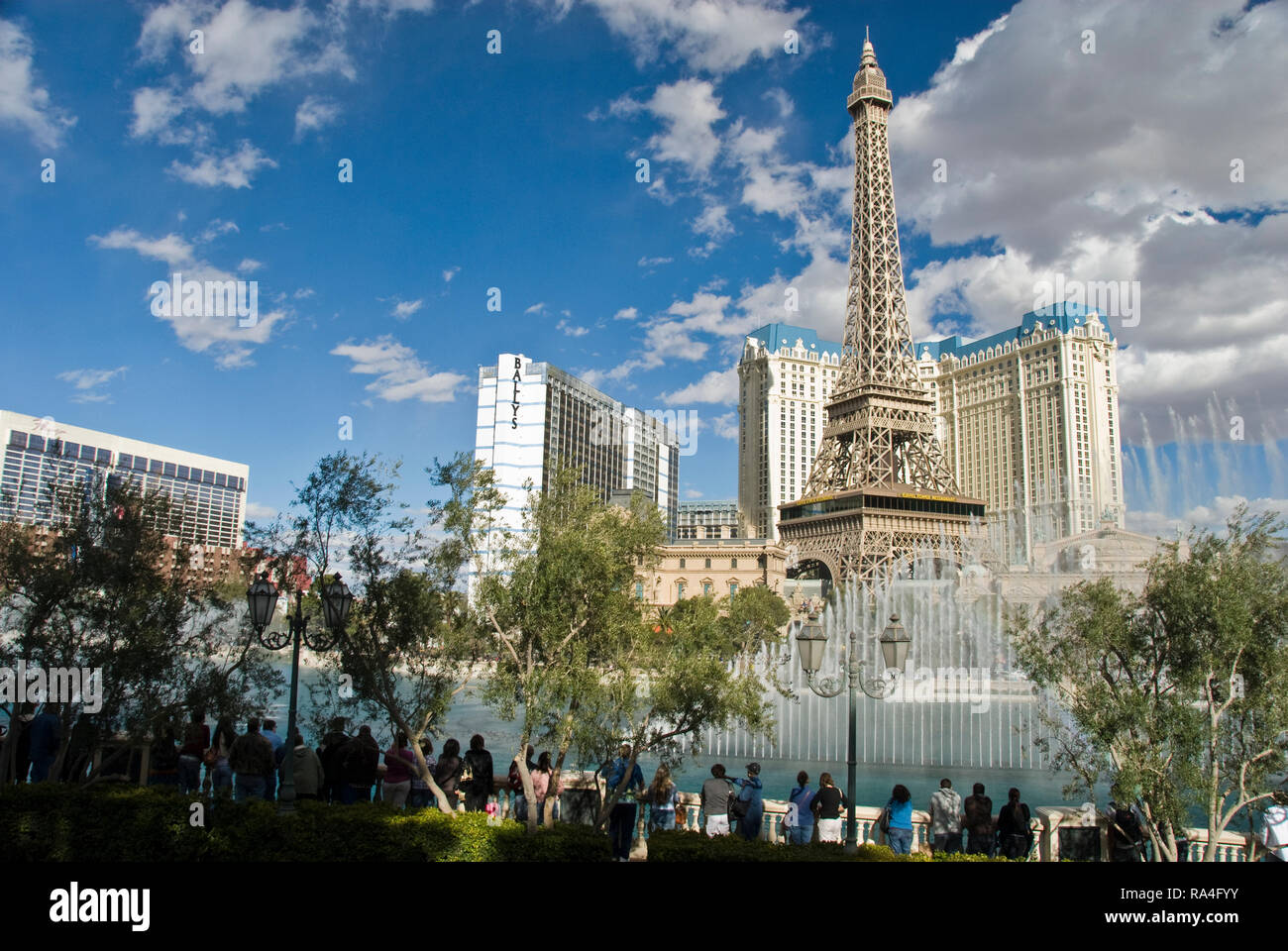The fountains of the Bellagio casino seen in front of the Paris Las Vegas hotel and casino on the Strip, in Las Vegas, Nevada. - Stock Image