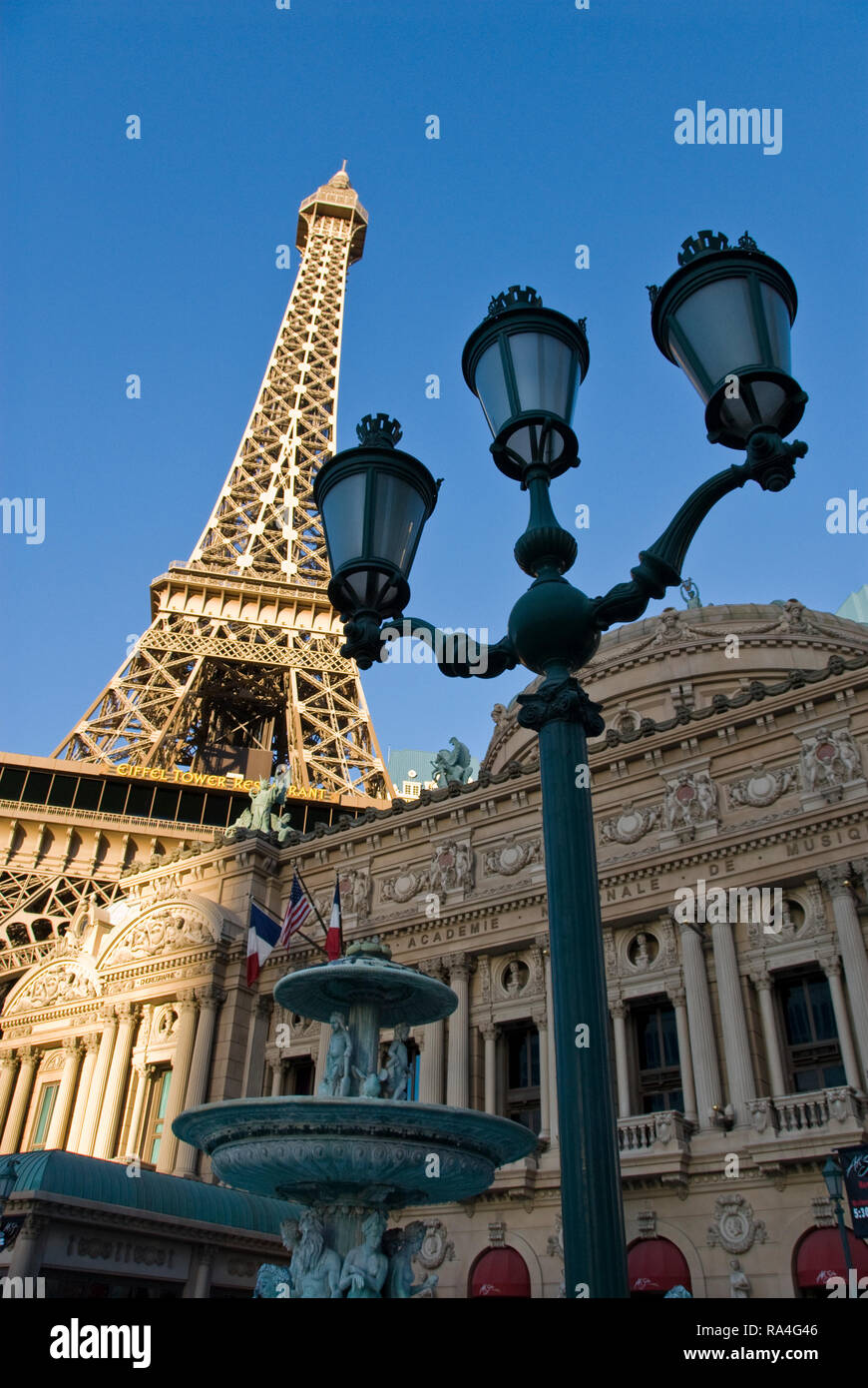 A replica iron Eiffel Tower stands above the Paris Las Vegas hotel and casino on the Strip, in Las Vegas, Nevada. - Stock Image