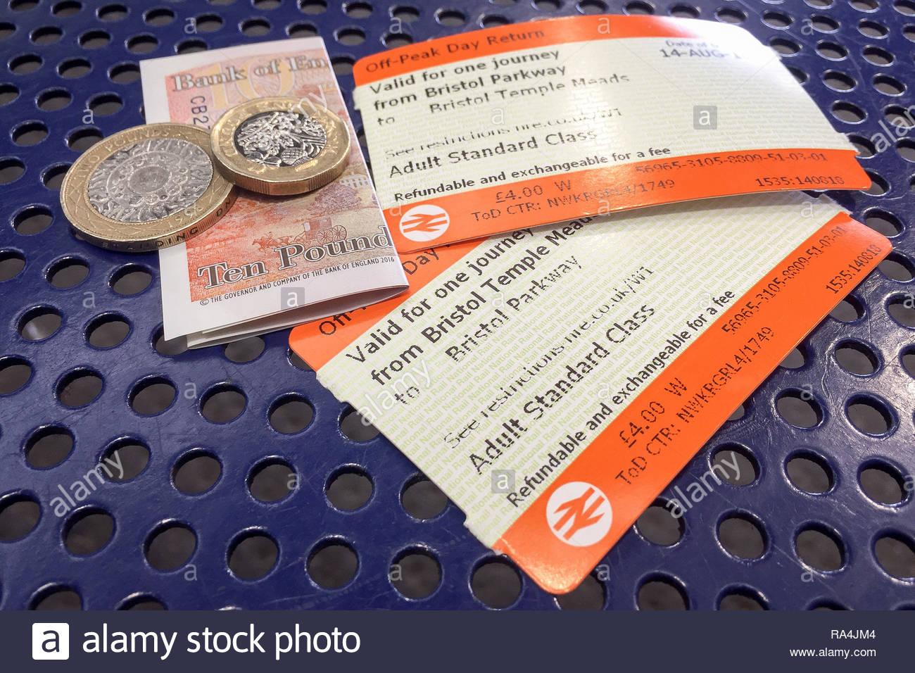 Embargoed to 0001 Wednesday January 02 File photo dated 14/8/2018 of off-peak day return rail tickets and money. Rail fares have increased by an average of 3.1% amid punctuality at a 13-year low. - Stock Image
