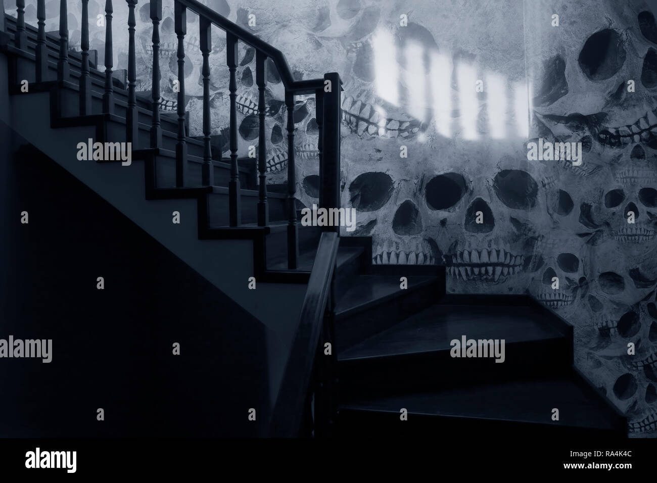 Frightening and surreal stairs to the loft: Phot composition with skulls on the wall. - Stock Image