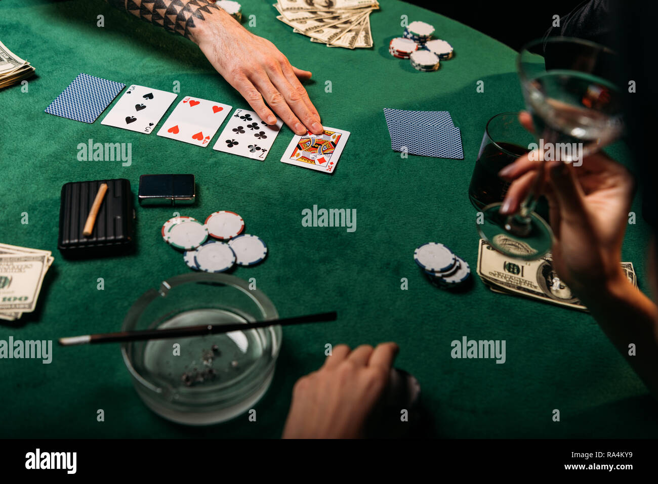 Incredible Cropped Image Of Woman And Tattooed Man Playing Poker Table Home Remodeling Inspirations Basidirectenergyitoicom
