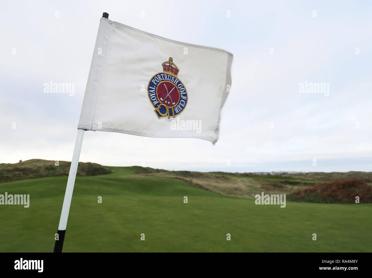 A flag on the course at Royal Portrush Golf Club in Co. Antrim.The organisers of golf's Open Championship have said they are staggered by the level of interest in the tournament's historic return to Northern Ireland. - Stock Image