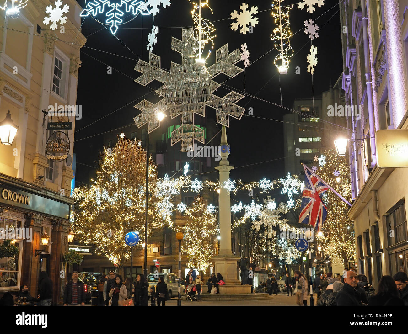 View of the London Seven Dials Christmas street decorations at night - Stock Image