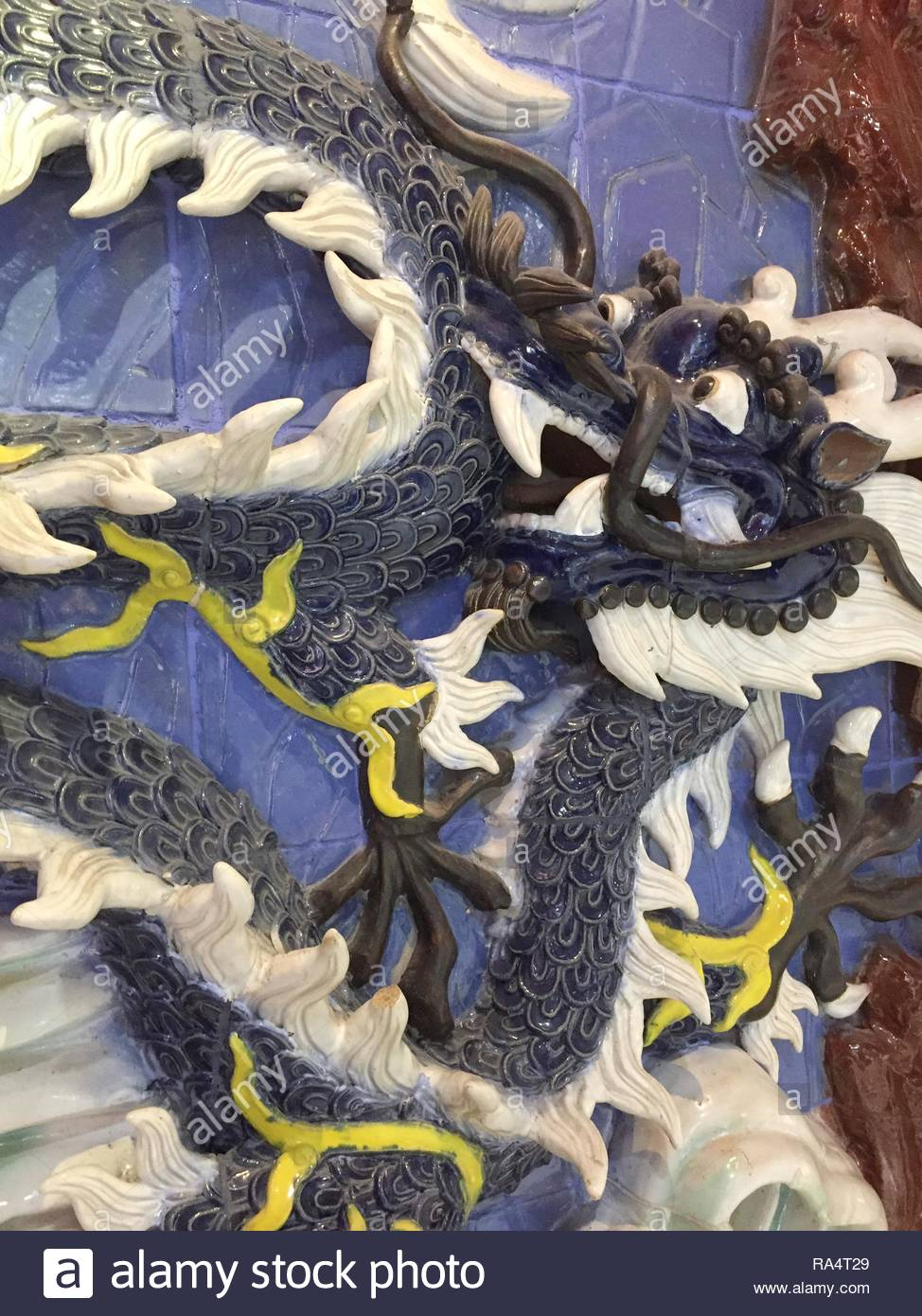 Ceramic figure of a Chinese dragon in Markham, Ontario, Canada. - Stock Image