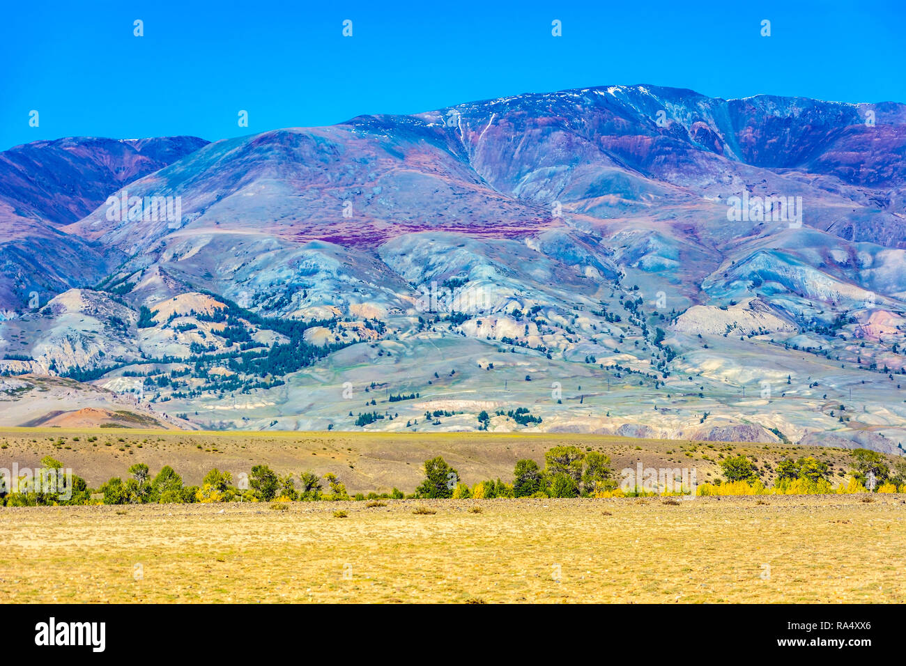 Multi-colored mountains in the valley of the river Kyzyl-Chin, Chui steppe, Altai Republic - Stock Image
