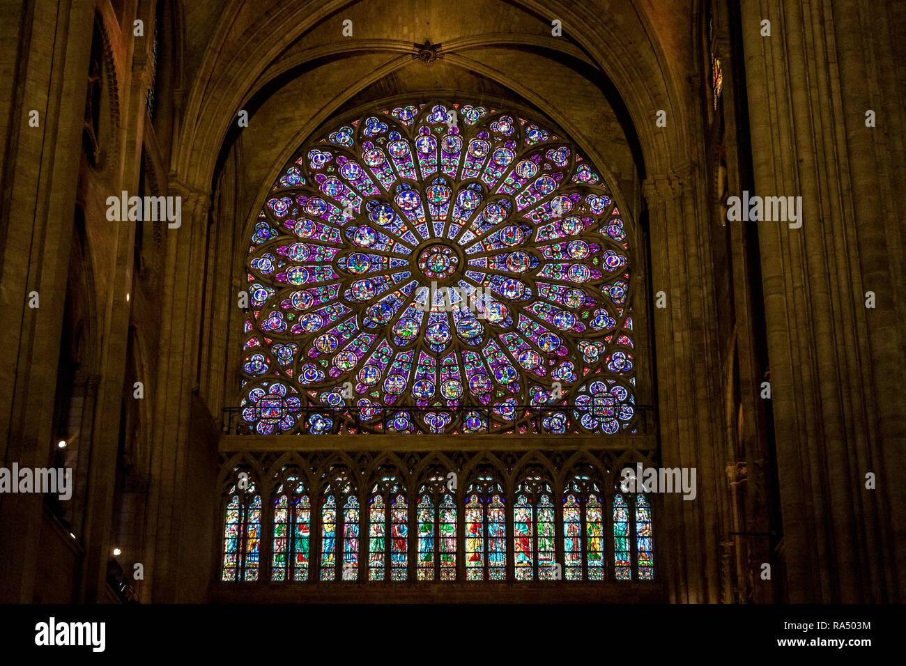 The North rose window of Notre-Dame de Paris also known as Notre Dame Cathedral a medieval Catholic cathedral on the Île de la Cité - Stock Image