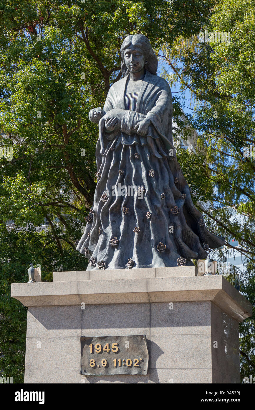 Nagasaki, Japan - October 25, 2018: Mother statue to honor the women victims, placed near the hypo center of the atomic bomb - Stock Image