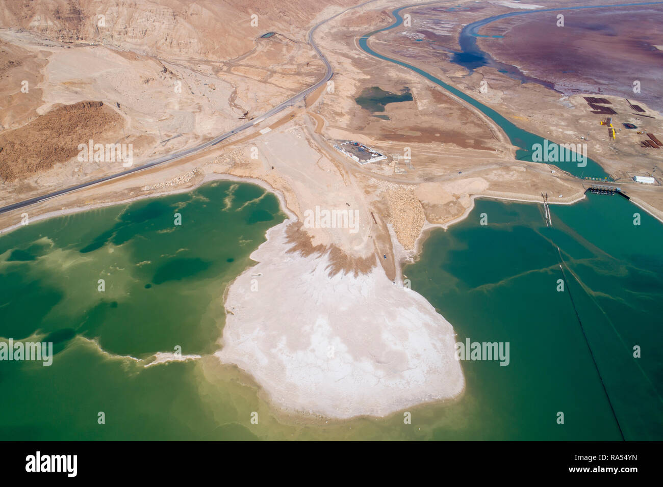 Aerial Photography with a drone. Elevated view of the canal leading water from the northern part to the Dead Sea Works, in the southern part on the sh - Stock Image