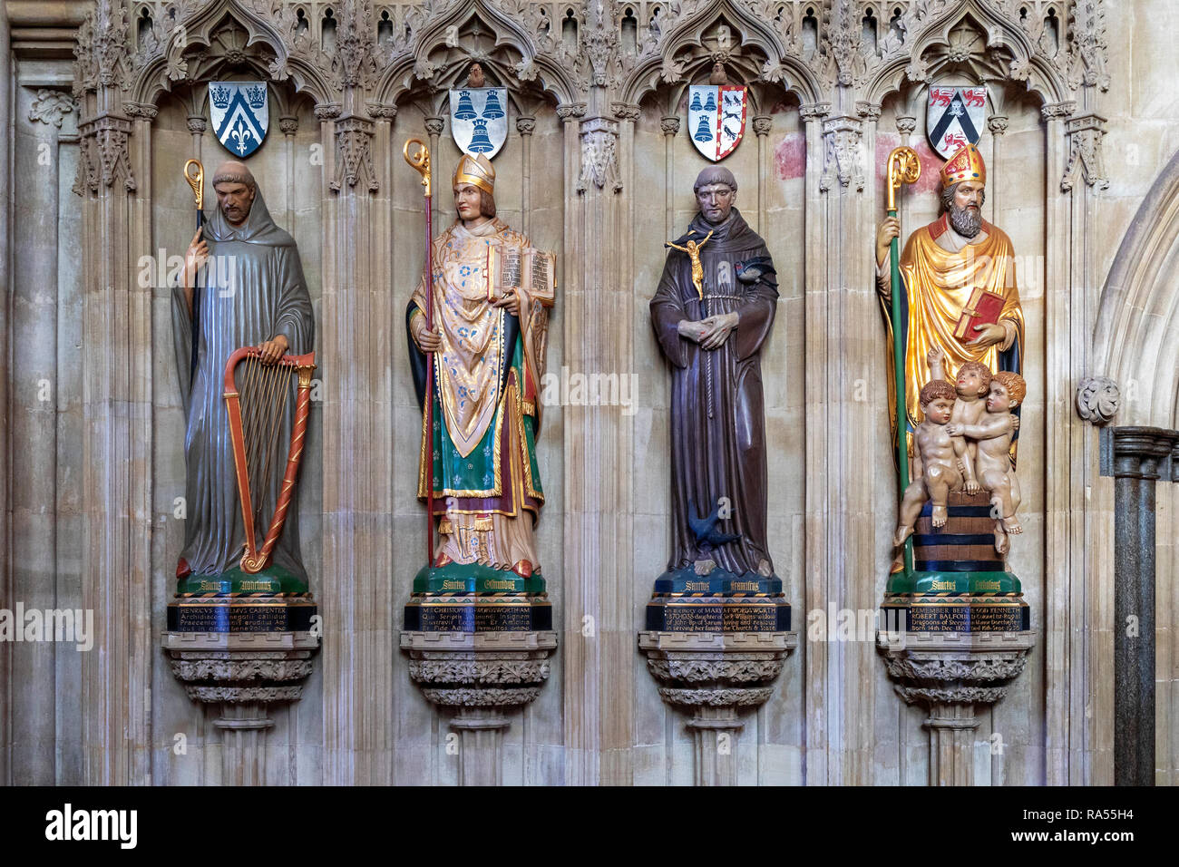 Row of four saints statues in Salisbury Cathedral - Stock Image