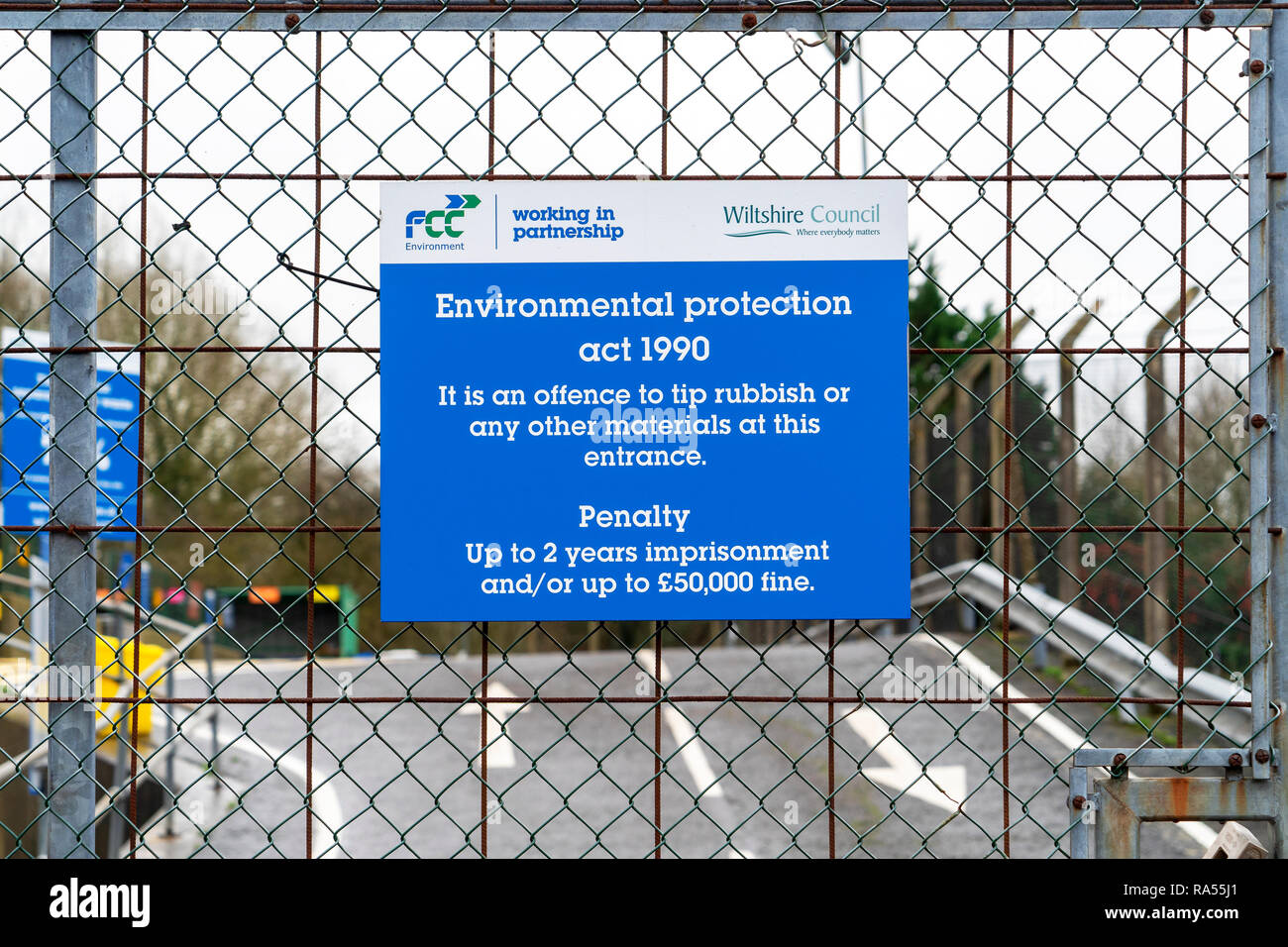 Environmental protection act 1990 sign on the gate at the entrance to a recycling centre - Stock Image