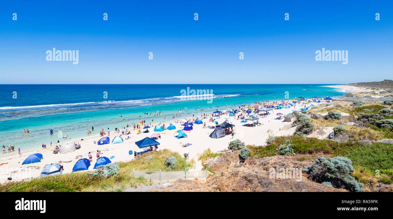 Beach tents, shelters and sunshades on a crowded beach in the middle of the day with a UV rating of 13. Yanchep, WA, Australia - Stock Image