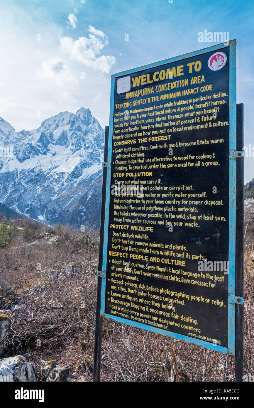 Sign welcoming trekkers to the Annapurna Conservation Area in Nepal Stock Photo