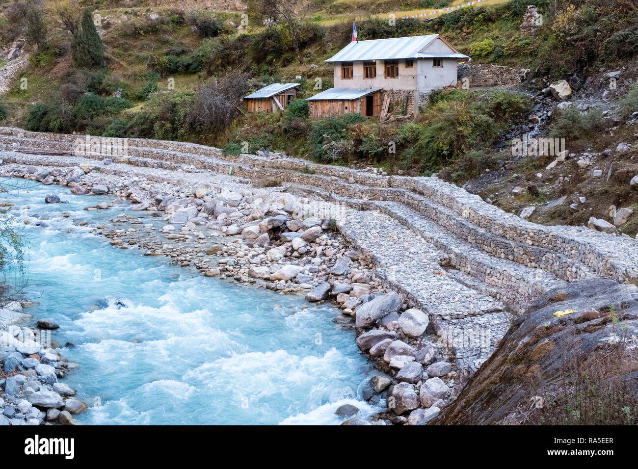 Reinforced river banks in the Langtang Valley, Nepal Himalayas - Stock Image