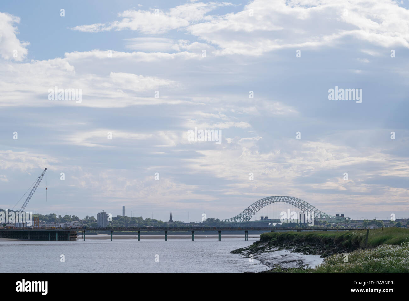 View of the Silver Jubilee Bridge spanning the River Mersey between Widnes and Runcorn - Stock Image