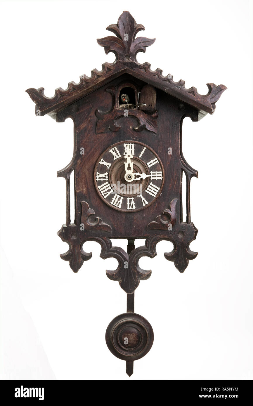 old black forest cuckoo clock in front of white background - Stock Image