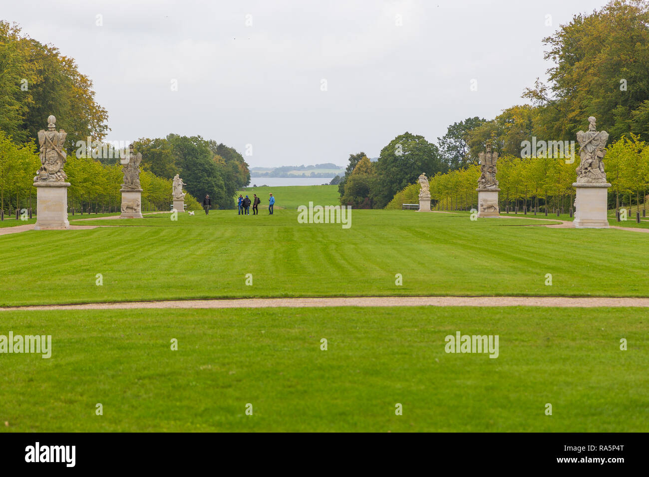Fredensborg, Denmark- 30 August 2014: Sculptures in Palace gardens. The largest historical gardens in the Baroque style. - Stock Image