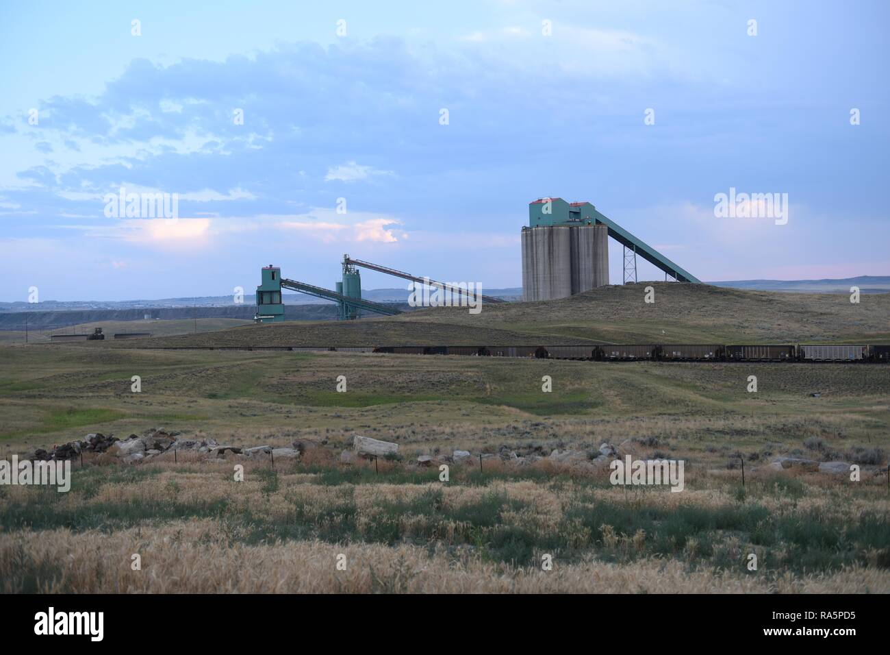 Coal train, coal mining silos, and processing operations in the Powder River Basin of Wyoming, USA. Stock Photo