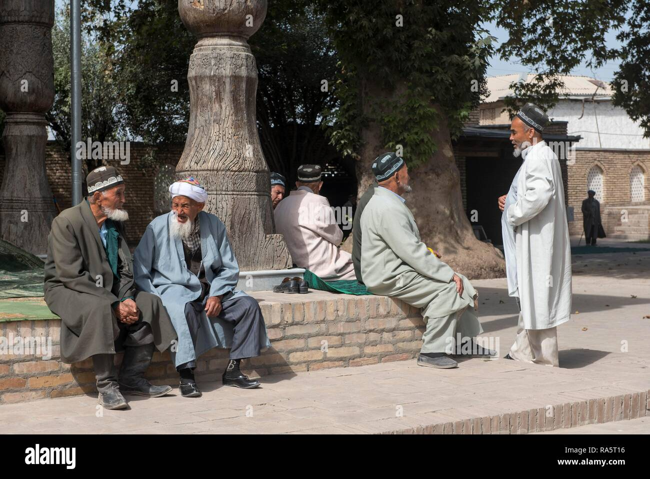 Men in front of the Friday Mosque, Shakhrisabz, Uzbekistan, Asia Stock Photo
