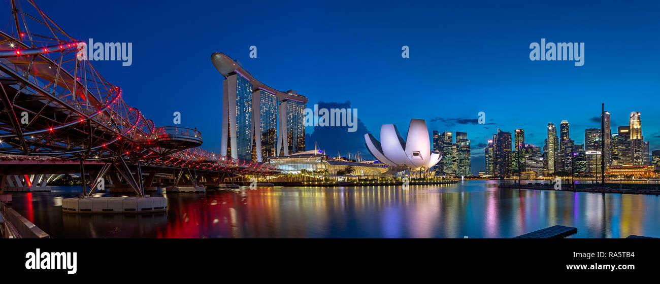 Marina Bay Sands Hotel, Art Science Museum, cityscape and Helix Bridge - Singapore - Stock Image