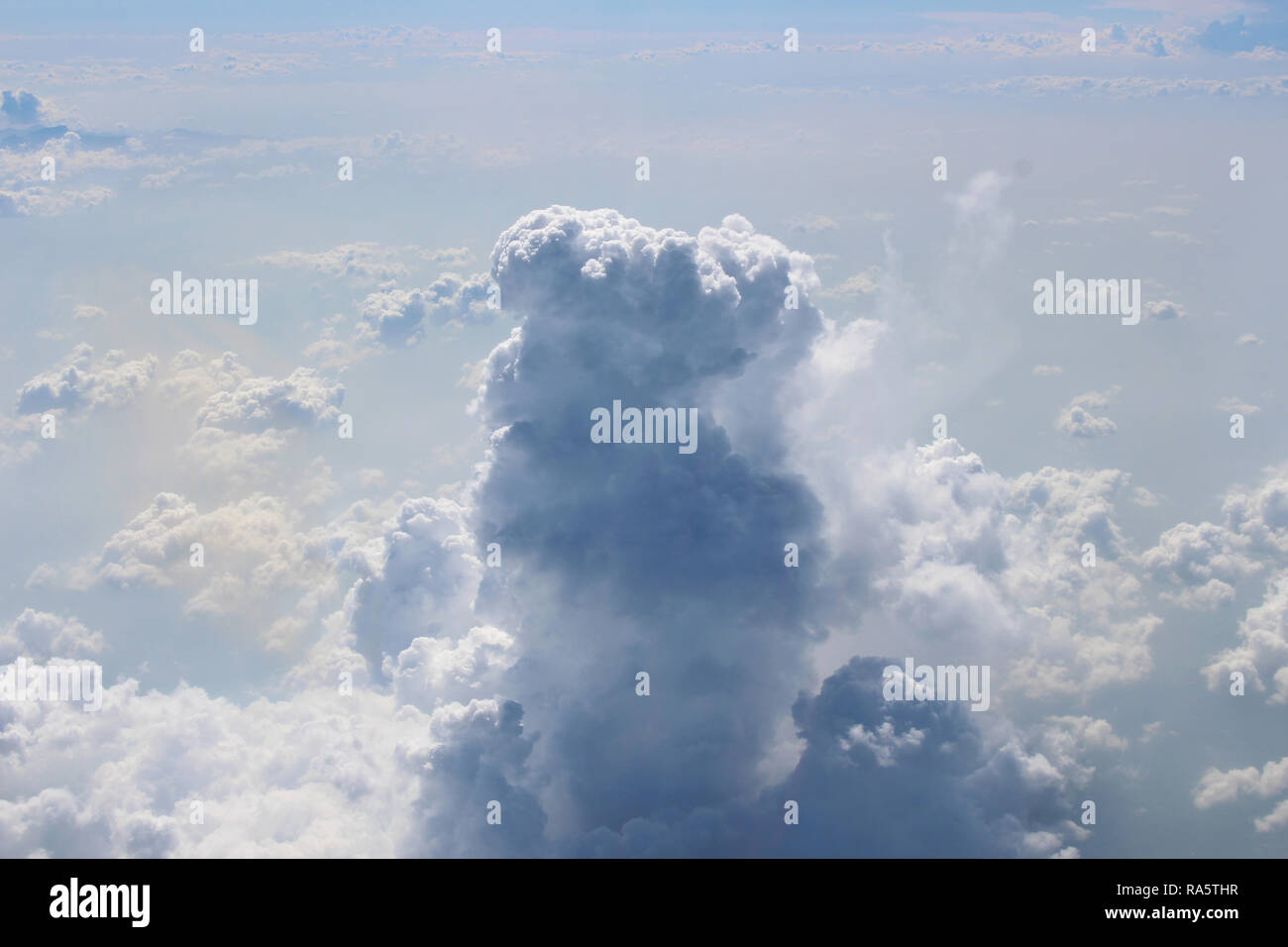 Aerial shot flying over and through cumulonimbus and cumulus clouds over Mexico - Stock Image