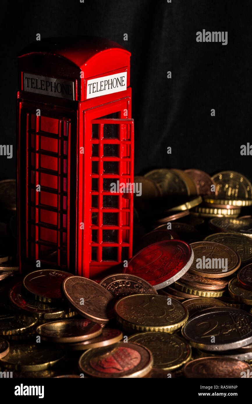 brexit concept - telephone kiosk, coins - Stock Image