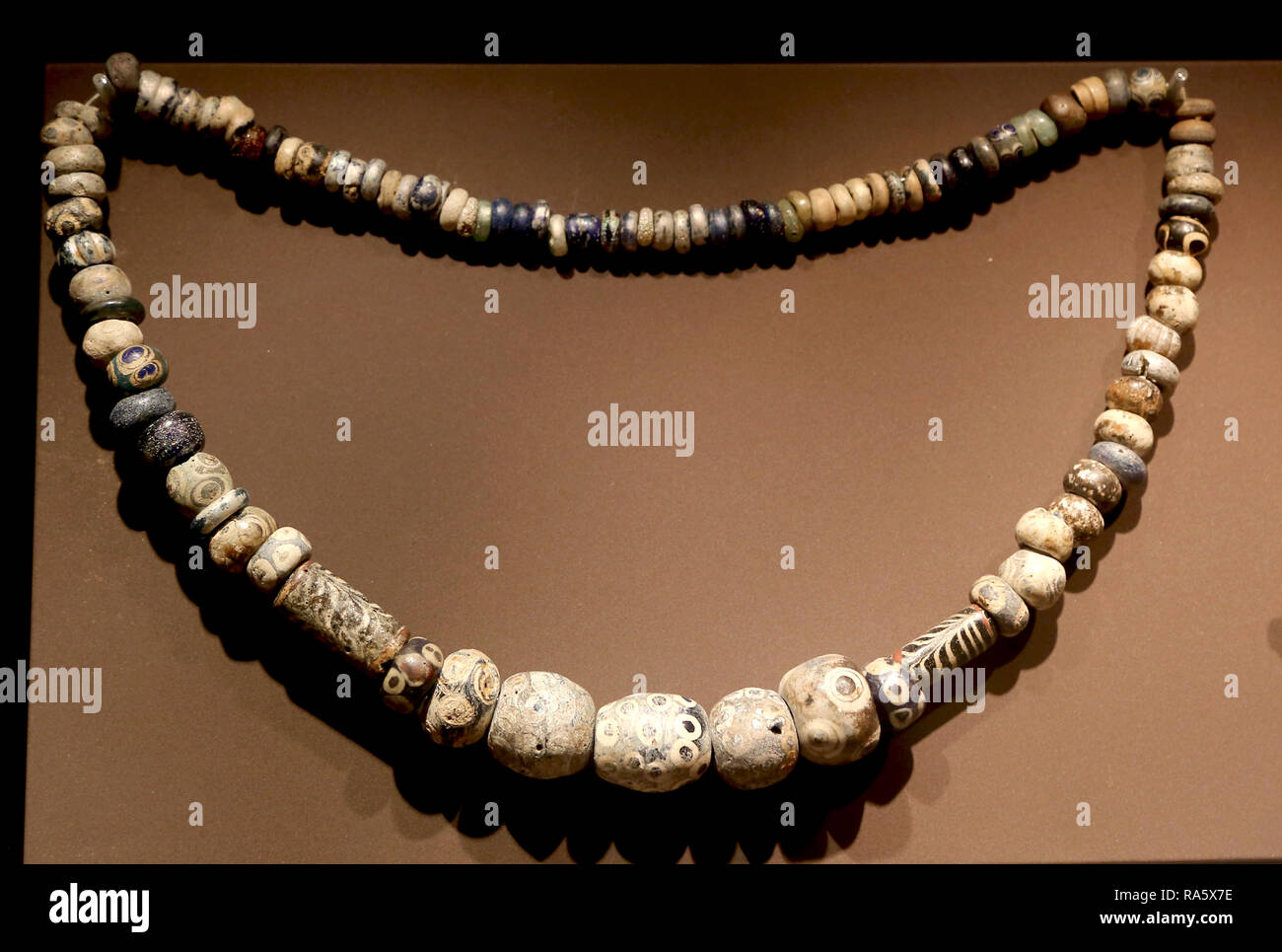 Necklace made with vitreous paste beads (cent. 5th-3rd BC). Punic-Ebusitan culture. Ibiza, Mallorca, Baleraic Islands. Spain. - Stock Image