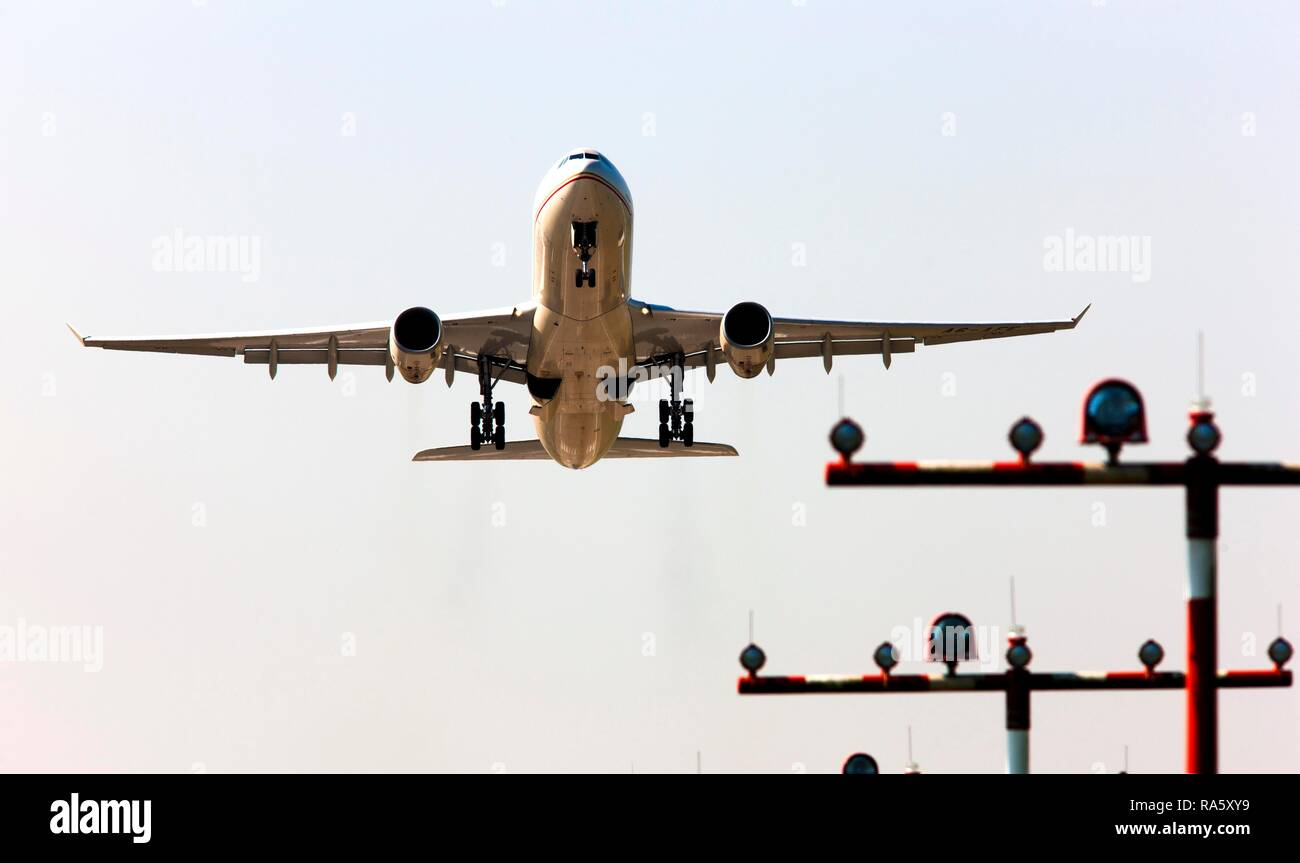 Runway landing lights in front of an Etihad Airways Airbus A330-300 taking off at Duesseldorf International Airport, Duesseldorf - Stock Image