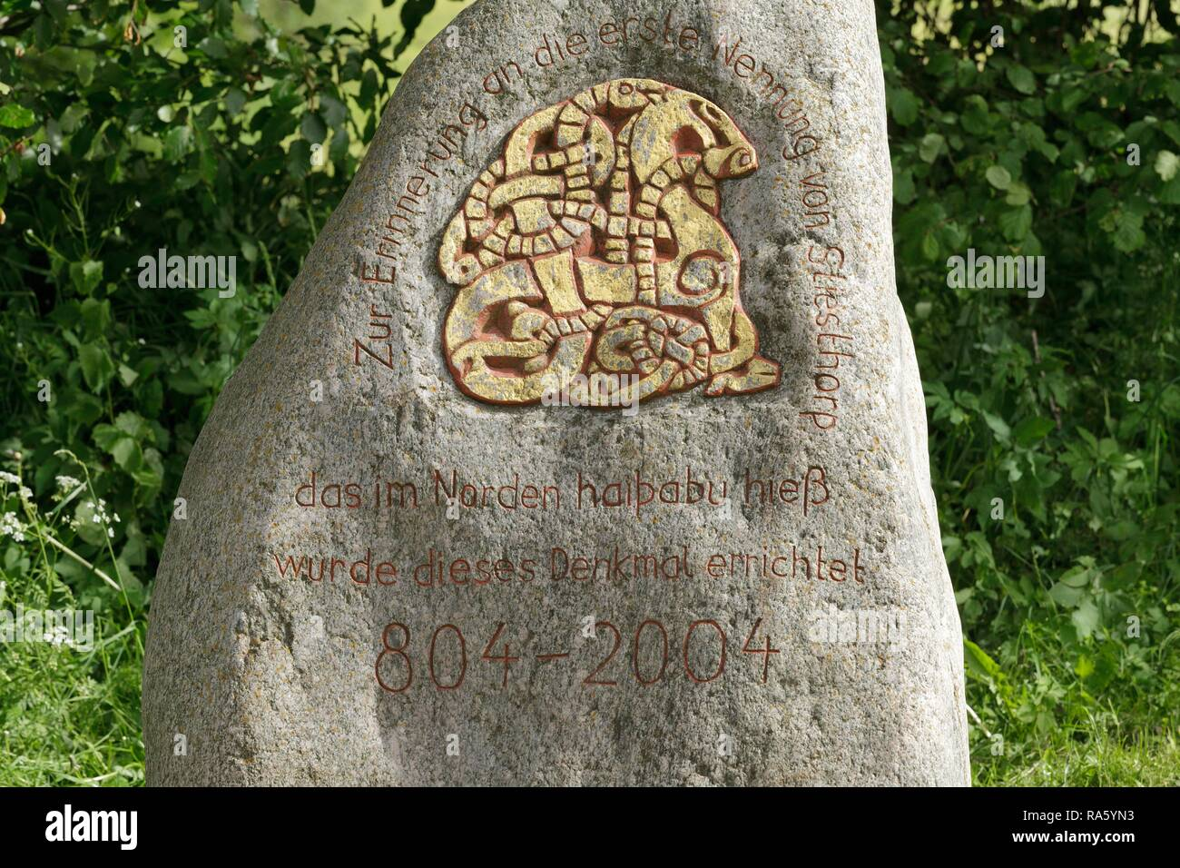Memorial stone at the roadside between the Vikings Museum and the Viking houses at Hedeby, Haithabu, Schleswig-Holstein, Germany - Stock Image