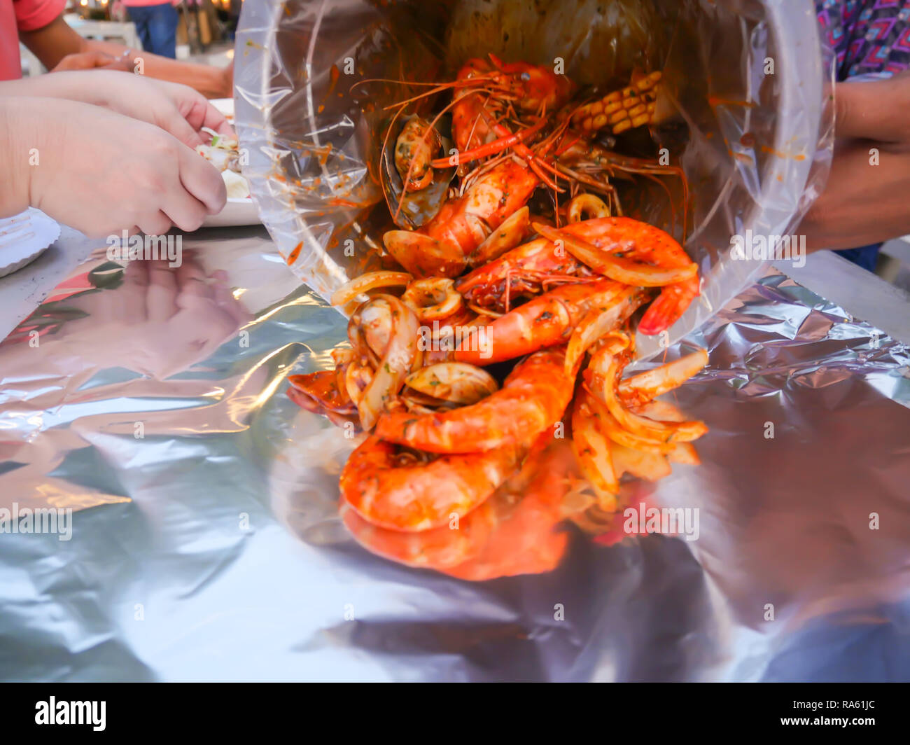 Shrimp Tank and mixed spicy seafood, Holy shrimp Tank street food - Stock Image