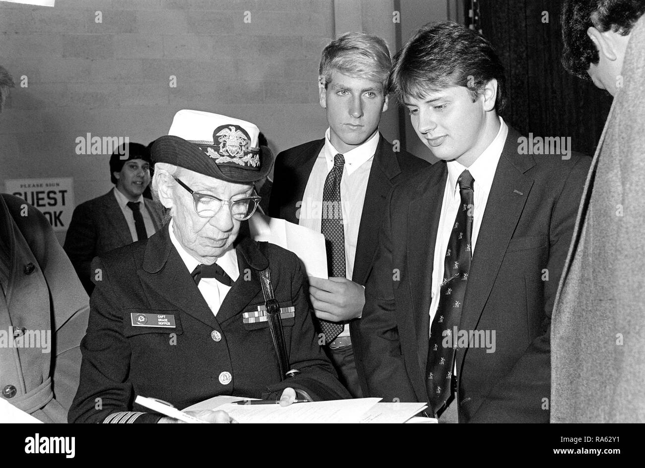 1983 - Captain Grace Murray Hopper signs autographs for students from Brewster Academy at the conclusion of a ceremony to dedicate a computer learning center in her name at the high school. - Stock Image
