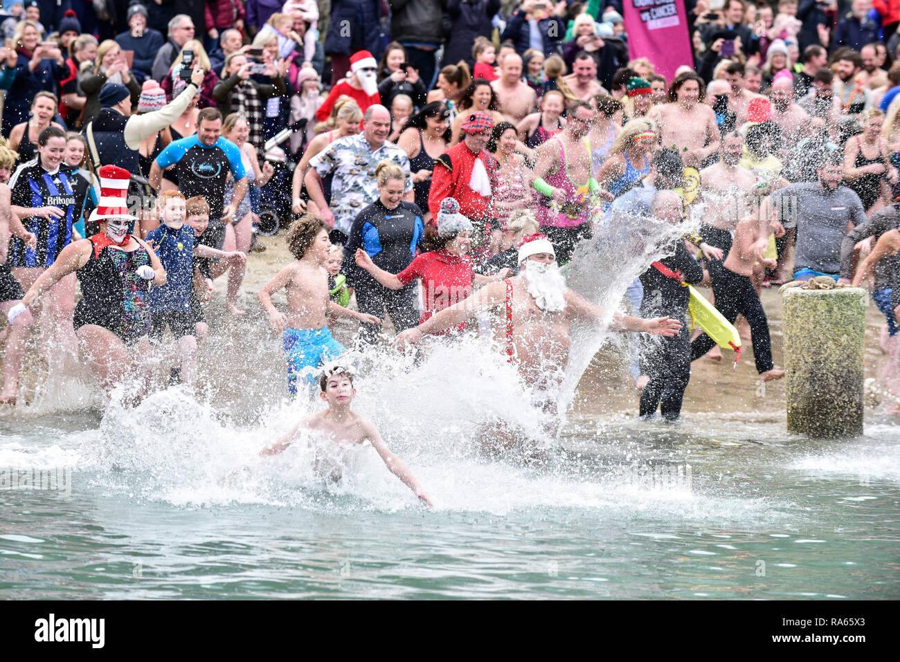 Newquay, Cornwall, UK.  1st January, 201p.  A massive turnout of hardy swimmers who braved to chilly waters of Newquay Harbour for the annual Newquay New Year's Day Dip.  The 'Dip' is held to raise funds for the CLIC SARGENT charity that gives support to young people with cancer.  Gordon Scammell/Alamy Live News. Stock Photo