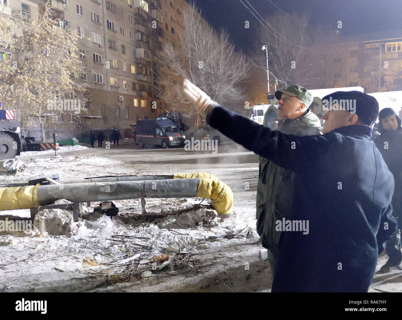 Magnitogorsk, Russia. 01st Jan, 2019. MAGNITOGORSK, RUSSIA - JANUARY 1, 2019: Russian Investigative Committee (SK) Chairman Alexander Bastrykin (L) and Chelyabinsk Region Governor Boris Dubrovsky at the site of an apartment block collapse. On December 31, 2018, a domestic gas explosion caused a partial collapse of a residential building at 164 Prospekt Karla Marksa Street killing nine people and leaving dozens missing. Press Office of the Chelyabinsk Region Governor/TASS Credit: ITAR-TASS News Agency/Alamy Live News - Stock Image