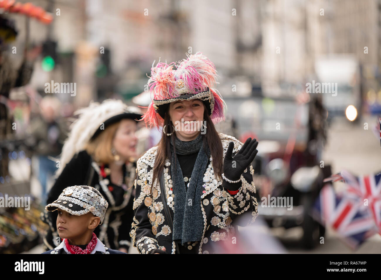 "London, UK.  1 January 2019.   The theme of the parade this year was ""London Welcomes the World"". With thousands of performers from a multitude of different countries and cultures from all around the world parade through central  London. Acts included the London Pearly Kings and Queens Society.  Credit: Ilyas Ayub / Alamy Live News - Stock Image"