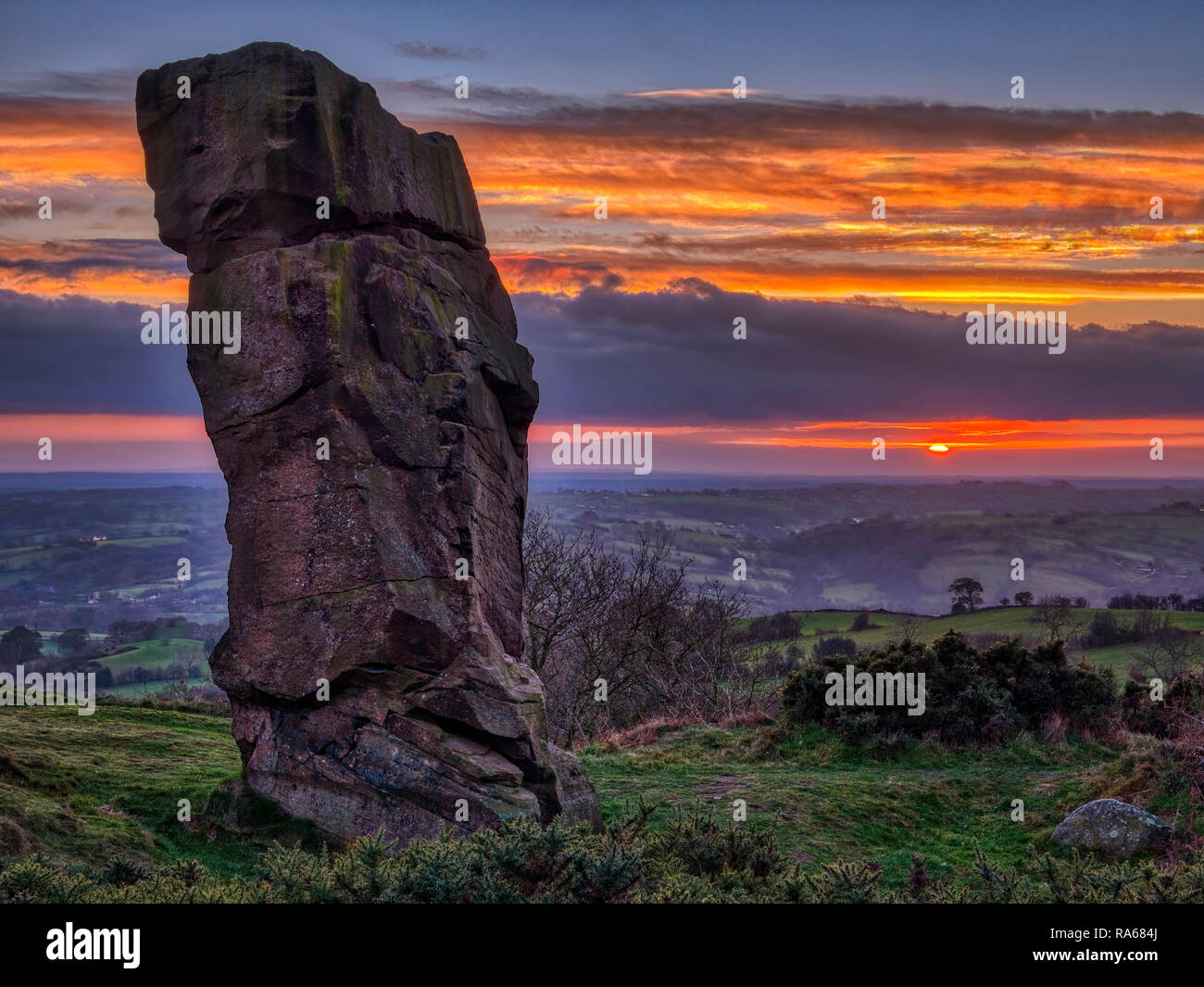 Alport Height near Wirksworth, Derbyshire, UK. 1st January, 2019. UK Weather: spectacular first sunset of 2019 Alport Stone at Alport Height near Wirksworth Derbyshire Credit: Doug Blane/Alamy Live News - Stock Image