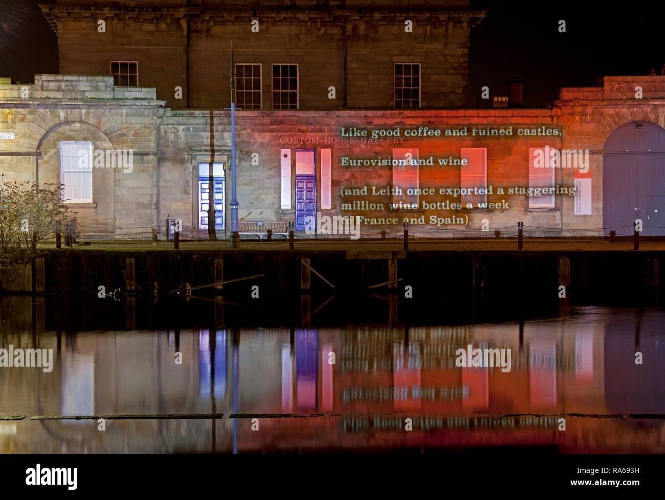 Edinburgh, Scotland, UK. 01 January 2019. The Tron and Custom House Leith, Edinburgh. Message from the Skies returns to Edinburgh's Hogmanay on Tuesday 1 January with a selection of love letters written to Europe. The words of six internationally celebrated writers - Billy Letford, Chitra Ramaswamy,  Kapka Kassabova, Louise Welsh, Stef Smith and William Dalrymple - will illuminate and animate buildings around the city during the first month of 2019. Message from the Skies runs until Friday 25 January 2019. Stock Photo