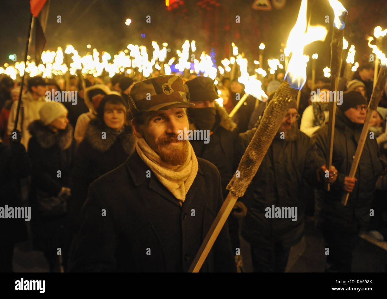 Kiev, Ukraine. 1st Jan, 2019. Activists of Ukrainian nationalist parties are seen holding torches and flares during the rally on the occasion of 110th birth anniversary of Stepan Bandera, founder of a Ukrainian Insurgent Army. In 1959 Stepan Bandera was killed by a KGB agent Bogdan Stashinsky in Germany. Credit: Sergei Chuzavkov/SOPA Images/ZUMA Wire/Alamy Live News - Stock Image