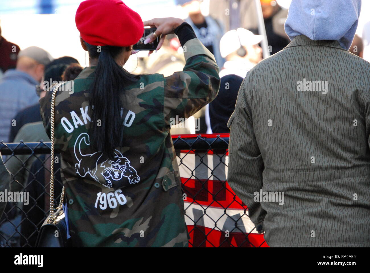 Oakland, California, USA. 1st Jan, 2019. A crowd gathered outside the Fruitvale BART station in Oakland, California, to mark the tenth anniversary since Oscar Grant was killed there by a BART police officer. Credit: Scott Morris/Alamy Live News - Stock Image