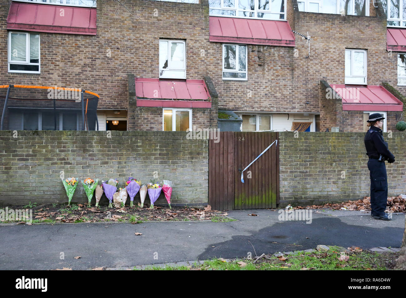 Southwark, London, UK 1 Jan 2019 - Floral tributes outside a house on John Ruskin Street in Camberwell, Southwark where a woman in her early 30s was stabbed to death early this morning.  Credit: Dinendra Haria/Alamy Live News - Stock Image