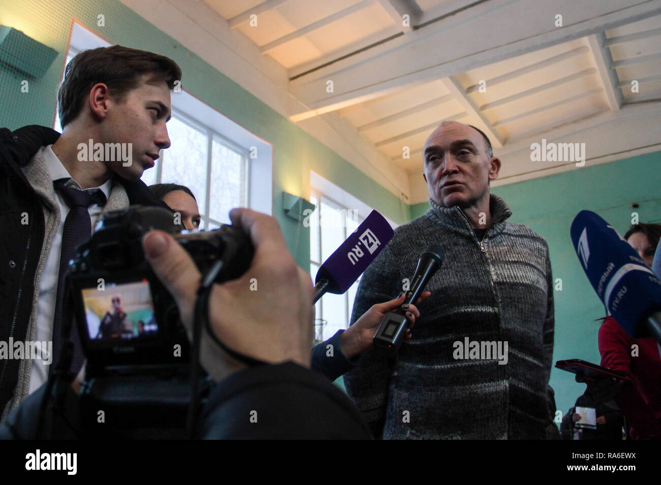 Magnitogorsk, Russia. 02nd Jan, 2019. MAGNITOGORSK, RUSSIA - JANUARY 2, 2019: Chelyabinsk Region Governor Boris Dubrovsky (back) interviewed at secondary school No 14 near the site of an apartment block collapse in Magnitogorsk. On December 31, 2018, at 4:00am, a domestic gas explosion caused a partial collapse of the residential building at 164 Prospekt Karla Marksa Street killing 21 people and leaving dozens missing. Ilya Moskovets/TASS Credit: ITAR-TASS News Agency/Alamy Live News - Stock Image