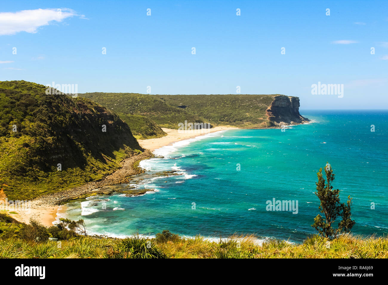 View onto Garie Beach from a higher angle in the Royal National Park near Sydney in summer with clear sky and blue sea (Sydney, Australia) - Stock Image